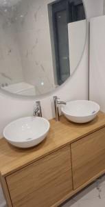 Photo de galerie - Pose meuble doubles vasques