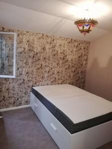 Photo de galerie - Impasse de lit IKEA avec des tiroirs